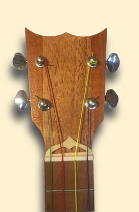Haunted Mansion inspired Banjo Uke headstock by Tiki King, from: www.tikiking.com