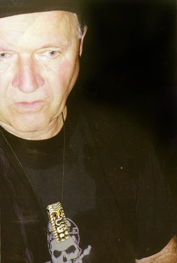 Dick dale wearing Tiki King necklace