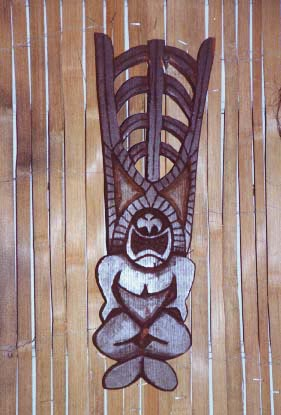 Tiki door pull, a carving by Tiki King