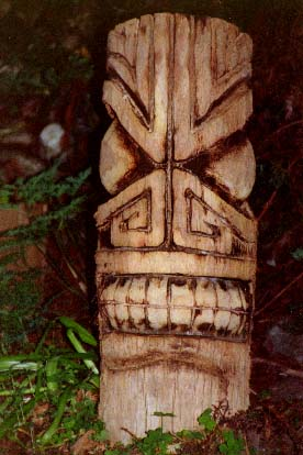 Palm log Tiki 1, a carving by Tiki King