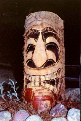Palm 2, a carving by Tiki King