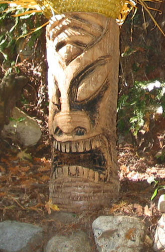 Palm log Tiki 3, a carving by Tiki King