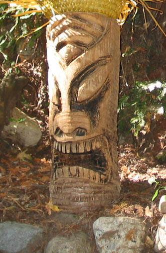 Palm log Tiki 3, a carving by Tiki King