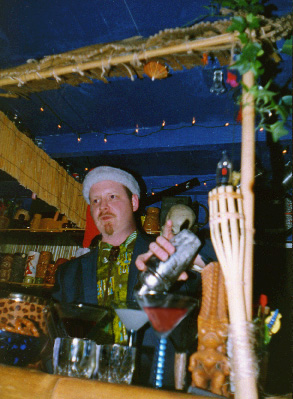 Tiki King pouring a drink