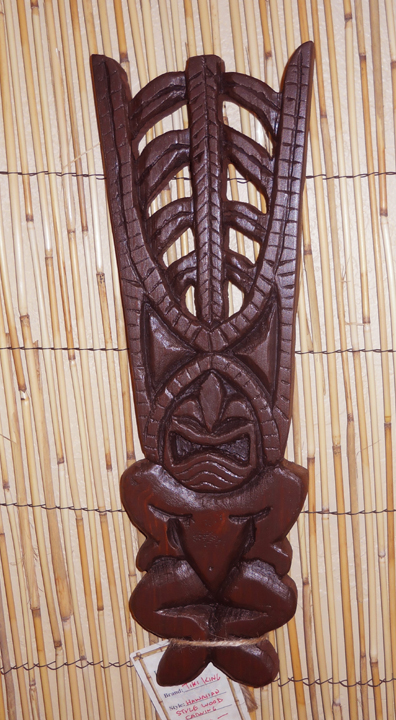 Pine Ku 2, a carving by Tiki King