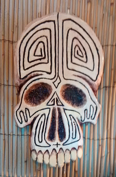 tattoo pine skull wall carving by Tiki King