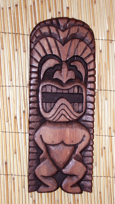Stylized Ku wall carving, based on a key chain by Tiki King