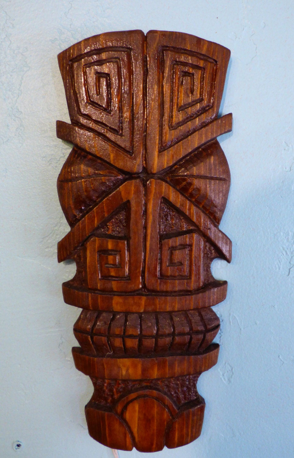 X Eyes, a carving by Tiki King