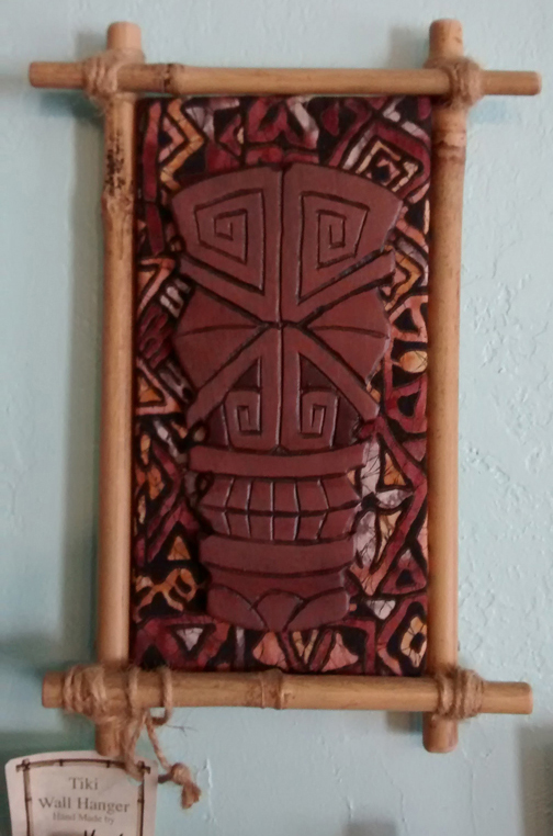 X-Eyes wall plaque, mixed media by Tiki King